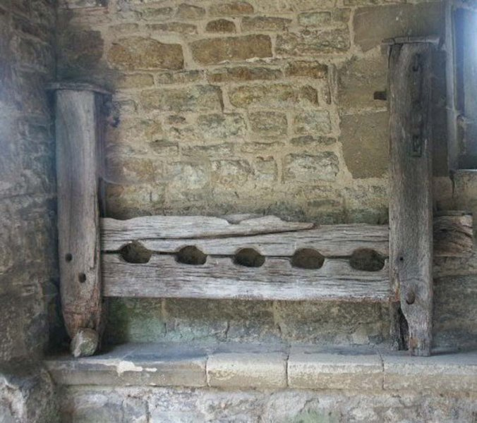 Dinton stocks in church porch